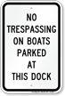 No Trespassing On Boats Parked At Dock Sign