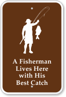 Fisherman Lives Here with His Best Catch Sign